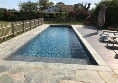 Rénovation piscine et habillage en pierres naturelles