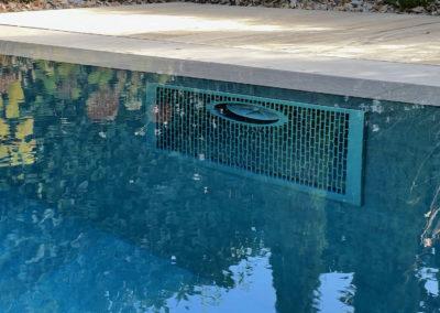 Création piscine miroir avec carrelage, volet solaire et nage à contre-courant à Genève